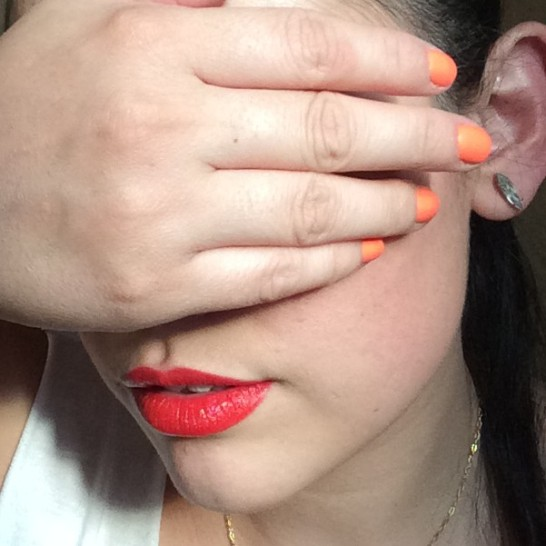 Red lips and orange nails
