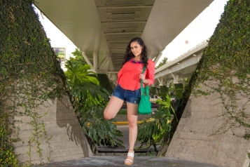 From POST: CORAL TOP, POM POM NECKLACE AND PRETTY GREEN PURSE