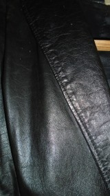 Black leather jacket detail