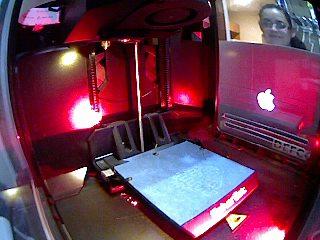Miau working on the 3D Printer