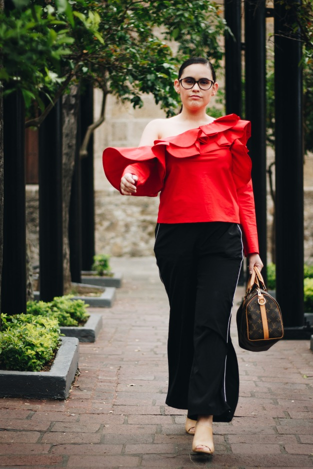 Bold in red walking front