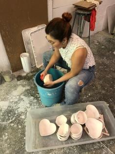 Syrihee lavando piezas