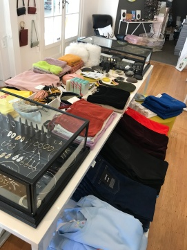 Anomie table with clothes and jewelry